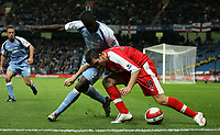Photo: Paul Thomas.<br /> Manchester City v Middlesbrough. The Barclays Premiership. 30/10/2006.<br /> <br /> Micah Richards (L) of Man City can't get the ball from Stuart Downing.