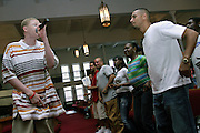 Tykym, 18, member of the Hells Most Wanted, a Christian Hip Hop group, is singing in front of the devotees during a Mass Service at the Hip Hop Church in Harlem, New York, NY., on Thursday, July 21, 2006. A new growing phenomenon in the United States, and in particular in its most multiethnic city, New York, the Hip Hop Church is the meeting point between Hip Hop and Christianity, a place where ëGodí is worshipped not according to religious dogmatisms and rules, but where the ëHoly Spirití is celebrated by the community through young, unique, passionate Hip Hop lyrics. Its mission is to present the Christian Gospel in a setting that appeals to both, those individuals who are confessed Christians, as well as those who are not regularly attending traditional Services, while helping many youngsters from underprivileged neighbourhoods to feel part of a community, to make them feel loved and to help them not to give up when problems arise. The Hip Hop Church is not only forward-thinking but it also has an important impact where life at times can be difficult and deceiving, and where young people can be easily influenced for the worst purposes. At the Hip Hop Church, members are encouraged to sing, dance and express themselves in any way that the ëSpirit of Godí moves them. Honours to students who have overcome adversity, community leaders, church leaders and some of the unsung pioneers of Hip Hop are common at this Church. Here, Hip Hop is the culture, while Jesus is the centre. Services are being mainly in Harlem, where many African Americans live; although the Hip Hop Church is not exclusive and people from any ethnic group are happily accepted and involved with as much enthusiasm. Rev. Ferguson, one of its pioneer founders, has developed ëHip-Hop Homileticsí, a preaching and worship technique designed to reach the children in their language and highlight their sensibilities, while bringing forth Christianity. This ëKeep It Realí evangelism style is the centrepiece of