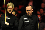 Mark Williams of Wales ® during his match v Neil Robertson of Australia (l) Bet Victor Welsh open snooker at the Newport centre in Newport, South Wales on Wed 26th Feb 2014.<br /> pic by Andrew Orchard, Andrew Orchard sports photography.
