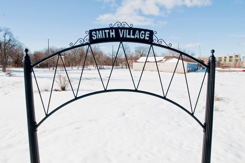 Matt Dixon | The Flint Journal..A sign for Smith Village stand in front of an empty lot on the corner of Williams Street and Saginaw Street in Flint. Smith Village is expected to be the only new subdivision in Genesee County this year. The project has been ongoing for more than a decade, and there's only a few houses that have been built.