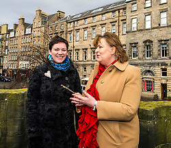 Pictured: Kathleen Brogan, managing Director of Mercat Tours and Fiona Hyslop used the Mercat Cross key to get a special view of the High Street.<br /> Ahead of parliamentary debate on the Year of History, Heritage and Archaeology, Culture Secretary Fiona Hyslop visited Edinburgh's Mercat Cross on the High Street to learn how Scotland is capitalising on the booming demand from tourists to explore the nation's history and genealogy. <br /> Ger Harley | EEm 31 January 2017