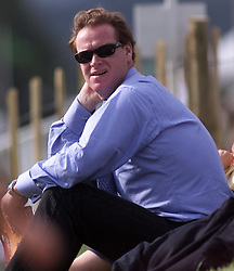 James Hewitt watches the final of the Veuve Clicquot Gold Cup polo competition at Cowdrey Park in Midhurst, West Sussex.