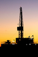 Photo Randy Vanderveen, .Sexsmith, Alberta.A rig is silhouetted against the morning sky southeast of Sexsmith.