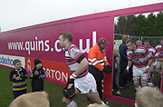 2004/05 Zurich Premiership,NEC Harlequins vs Gloucester, The Stoop,Twickenham, ENGLAND:<br /> Gloucester skipper Jake Boer leads his Gloucester team out through the door in the fence, shielding the work on the new stand from the spectators.<br /> <br /> Twickenham. Surrey, UK., 5th February 2005, Zurich Premiership Rugby,  The Stoop,  [Mandatory Credit: Peter Spurrier/Intersport Images],