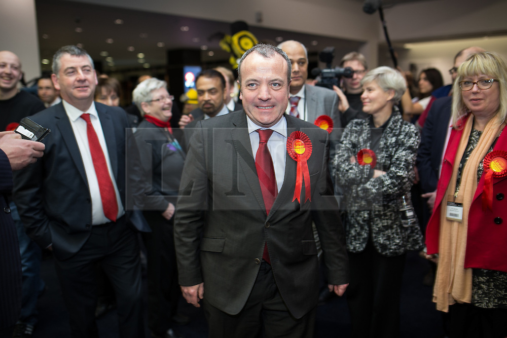 © Licensed to London News Pictures . 14/02/2014 . Manchester , UK . Labour 's MIKE KANE enters the counting hall . The count for the Wythenshawe and Sale East by-election , at Manchester Central this evening . Photo credit : Joel Goodman/LNP