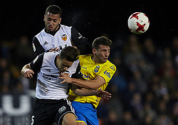 January 9, 2018 - Valencia, Valencia, Spain - Ruben Vezo (L) of Valencia CF heads the ball next to his teammate Gabriel Paulista(C) of Valencia CF and Calleri of UD Las Palmas during the Copa del Rey Round of 16, second leg game between Valencia CF and Las Palmas at Mestalla on January 9, 2018 in Valencia, Spain  (Credit Image: © David Aliaga/NurPhoto via ZUMA Press)