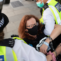 Ruth Jarman is handcuffed and arrested during civil disobedience protests in Parliament Square London urging the government to take action on climate change. Jarman is part of an ecumenical group called Christian Climate Action, several of whom were arrested along with hundreds of other people from Extinction Rebellion.
