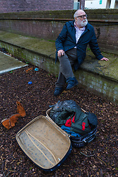 Danny Gallivan, chairman of the Regent's Park Gardening Association sits in the children's play area of the allotment where it appears homeless people have taken up residence in a wendy house and are using adjacent sheds to store their bedding. Munster Square, Camden, March 18 2019.