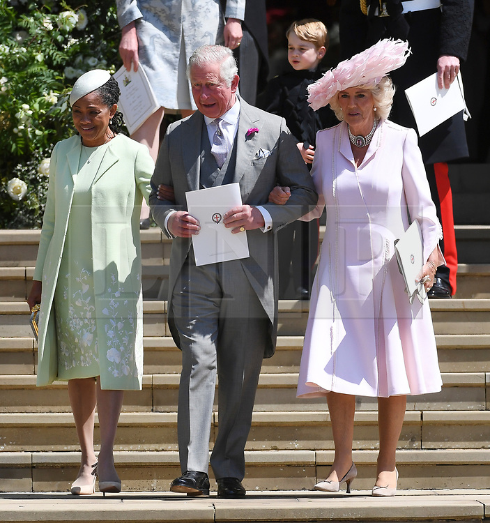 © Licensed to London News Pictures. 19/05/2018. London, UK.  DORIAN RAGLAND, mother of Meghan Markle leaves the chapel with PRINCE CHARLES and CAMILLA, DUCHESS OF CORNWALL at the wedding of Prince Harry, The Duke of Sussex and Meghan Markle, The Duchess of Sussex at St George's Chapel in Windsor Castle. Photo credit: LNP