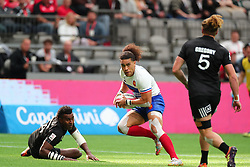 March 9, 2019 - Vancouver, BC, U.S. - VANCOUVER, BC - MARCH 09: Pierre Gilles Lakafia (8)  of France runs between Joe Ravouvou (4) and Scott Gregory (5) of New Zealand during day 1 of the 2019 Canada Sevens Rugby Tournament on March 9, 2019 at BC Place in Vancouver, British Columbia, Canada. (Photo by Devin Manky/Icon Sportswire) (Credit Image: © Devin Manky/Icon SMI via ZUMA Press)
