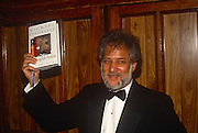 Sri Lankan-born Canadian Novelist Michael Ondaatje holds up a copy of his book 'The English Patient' on the night he shared the Booker Prize for literature with Barry Unsworth's Sacred Hunger, on 1/10/1992 in London, England. The Man Booker Prize for Fiction is a literary prize awarded each year for the best original novel, written in the English language and published in the UK.