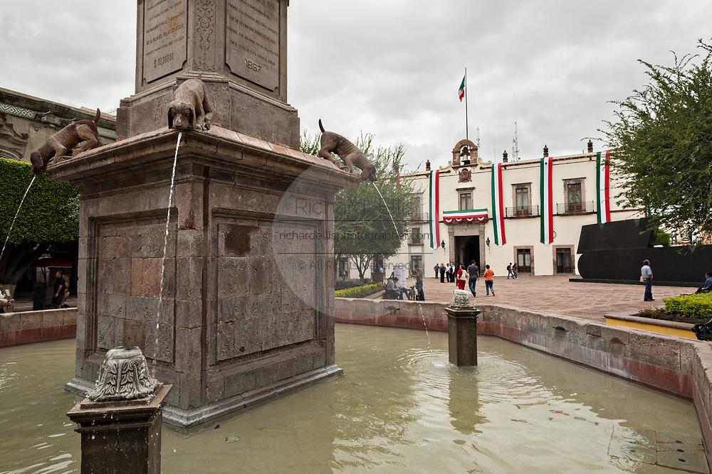 Fuente de los Perritos or Puppy Fountain outside the government palace or Palacio de Gobierno along the Plaza de Armas in the old colonial section of Santiago de Queretaro, Queretaro State, Mexico.