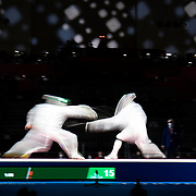 TOKYO, JAPAN - JULY 30:  Masaru Yamada of Japan (left) in action against Nikita Glazkov of ROC during the Japan V ROC gold medal match won by Japan 45-36  during the fencing epee team event for men at the Makuhari Messe at the Tokyo 2020 Summer Olympic Games on July 30, 2021 in Tokyo, Japan. (Photo by Tim Clayton/Corbis via Getty Images)