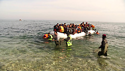 March 12, 2016 - Lesvos, Greece - Refugees and migrants arriving at  Lesvos island, Greece on March 12,2016. Refugees arriving at Lesvos in a rubber dinghy boat after they flee from their home country. They travel from Turkey to Greece to get to Europe. Grroups of Refugees and Migrants aboard dinghies reach the Greek Island of Lesvos after crossing the cold Aegean sea from Turkey arriving thirsty and helpless. Same time from the Greek/European site Frontex helicopters and vessels are patroling the area and saving refugees on boats. Fishermen found an empty dinghy in the sea. (Credit Image: © Nicolas Economou/NurPhoto via ZUMA Press)