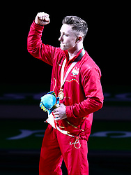 England's Nile Wilson celebrates with his gold medal won in the Men's Horizontal Bar at the Coomera Indoor Sports Centre during day five of the 2018 Commonwealth Games in the Gold Coast, Australia.