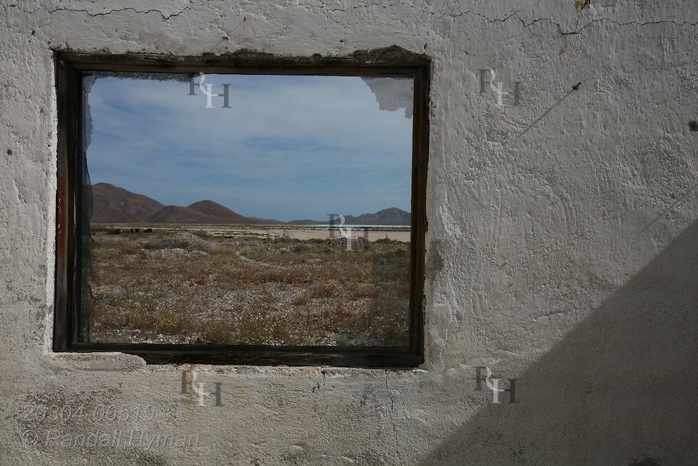 Window frames desert landscape of Isla Carmen at Salinas Bay; Baja, Mexico.