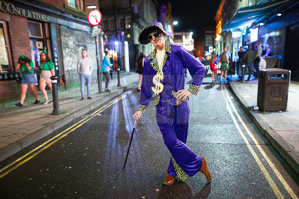 © Licensed to London News Pictures . 26/12/2017. Wigan, UK. A pimp. Revellers in Wigan enjoy Boxing Day drinks and clubbing in Wigan Wallgate . In recent years a tradition has been established in which people go out wearing fancy-dress costumes on Boxing Day night . Photo credit: Joel Goodman/LNP