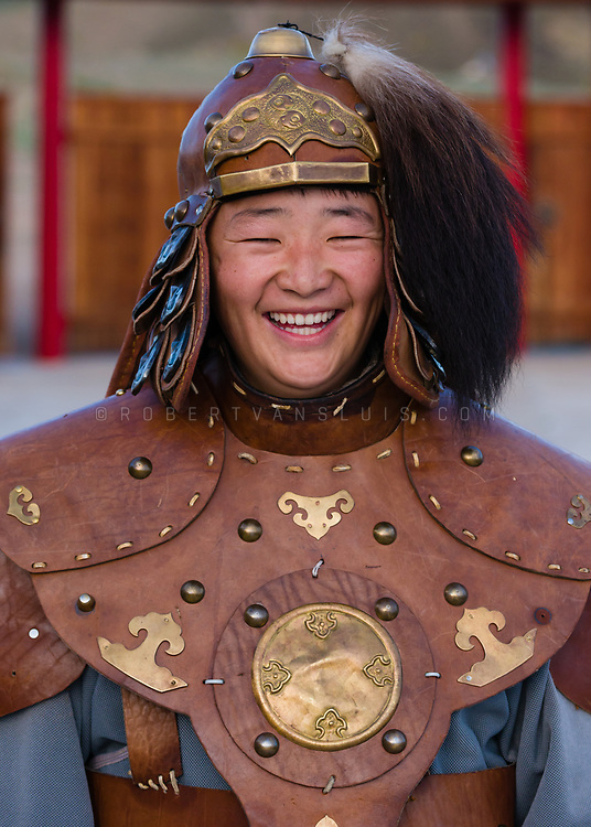 A young man wears traditional Mongolian dress at a fashion show at Ongin Khiid Monastery, Mongolia. Photo © robertvansluis.com