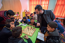 19 February 2020, Amman, Jordan: Under supervision of Mathematics teacher Mohammad Alhamayel, a group of boys make use of a room called 'Spaces for Creativity' at the Al Areen Secondary School for Boys in the Al Jeeza district. The room has emerged through a project by the Lutheran World Federation, whereby the school buildings and classrooms have been refurbished, and a school initiative has introduced 'Spaces for Creativity' as a way of nurturing students' creative and thinking skills. This type of learning environment is otherwise rare in Jordanian public shools. The Al Areen Secondary school teaches boys from 4th - 12th grade, most of them Jordanian, but a few also of other nationalities.