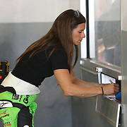 Danica Patrick, driver of the #7 GoDaddy Chevrolet is seen signing autographs for fans in the garage area during practice for the 60th Annual NASCAR Daytona 500 auto race at Daytona International Speedway on Friday, February 16, 2018 in Daytona Beach, Florida.  (Alex Menendez via AP)