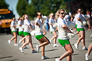 Samantha Russo leads the Lakeland High School varsity cheerleading squad in a dance routine down the parade route for the Rathdrum Days parade on Saturday morning.