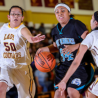 012514       Cable Hoover<br /> <br /> Navajo Prep Eagle Khadijah Jackson (34) pushes past Tohatchi Cougars LaRayne Halona (50) and Jennelle Mitchell (20) Saturday at Tohatchi High School.