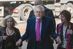 London, June 5th 2014. Entertainer Rolf Harris arrives with his daughter Bindi, left and niece, Jenny, right, at Southwark Crown Court as his trial on 12 charges of indecent assault against four girls ages 7 to 19 continues.