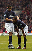 Fotball<br /> Premier League 2004/05<br /> Southampton v Tottenham<br /> 5. mars 2005<br /> Foto: Digitalsport<br /> NORWAY ONLY<br /> Tottenham's Mido (L) consoles strike partner Jermain Defoe following a missed chance to score