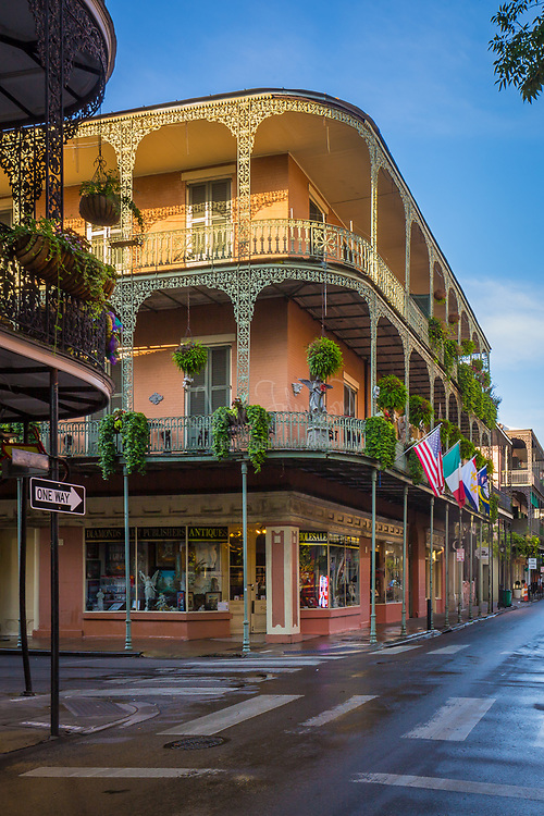 Typical buildings in the French Quarter area of New Orleans, Louisiana.  The French Quarter is the oldest and most famous and visited neighborhood of New Orleans. It was laid out in French and Spanish colonial times in the 18th century. While it has many hotels, restaurants, and businesses catering to visitors, it is best appreciated when you recall that it is still a functioning mixed-use residential/commercial neighborhood where locals live.