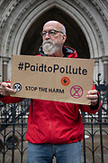 Paid to Pollute claimant Jeremy Cox outside the Royal Courts of Justice on 2nd October 2021 in London, United Kingdom. Kairin and Jeremy are two of the three climate activists taking the K government to court over the billions of pounds of public money it spends supporting the oil and gas industry, as part of the Paid to Pollute campaign. <br /> <br /> Jeremy Cox is a retired former oil worker, current Extinction Rebellion activist, beekeeper, green woodworker and amateur baker.