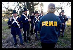 Jan 7th, 2006. A representative from FEMA talks to soldiers at the Battle of New Orleans re-enactment at Packenham Oaks in Chalmette near New Orleans, Louisiana to ensure any that need assistance are claiming it. Period costumed British and American men along with 'irregulars' from the Independence/Civil War period commemorated the battle of Jan 8th, 1815 - the last battle of the war of 1812. The British led by General Edward Packenham were soundly defeated by troops hastily assembled by General Andrew Jackson.