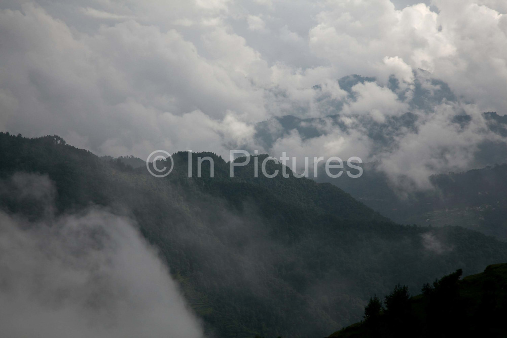 A view of the valleys in Dolakha district. The summer months is the rainy season and clouds are often obscuring the view of the Himalaya.