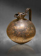 Phrygian bronze trefoil spouted jug from Gordion . Phrygian Collection, 8th century BC - Museum of Anatolian Civilisations Ankara. Turkey. Against a grey background .<br /> <br /> If you prefer you can also buy from our ALAMY PHOTO LIBRARY  Collection visit : https://www.alamy.com/portfolio/paul-williams-funkystock/phrygian-antiquities.html  - Type into the LOWER SEARCH WITHIN GALLERY box to refine search by adding background colour, place, museum etc<br /> <br /> Visit our CLASSICAL WORLD PHOTO COLLECTIONS for more photos to download or buy as wall art prints https://funkystock.photoshelter.com/gallery-collection/Classical-Era-Historic-Sites-Archaeological-Sites-Pictures-Images/C0000g4bSGiDL9rw