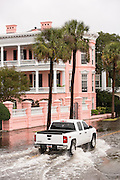 A truck plows through floodwater along the Battery past the Palmer House Inn in the historic district as Hurricane Joaquin brings heavy rain, flooding and strong winds as it passes offshore October 4, 2015 in Charleston, South Carolina.