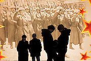 Moscow, Russia, 05/11/2005..People on Red Square in front of decorations erected for a military parade on November 7 to commenorate a similar parade during World War Two when soldiers left for the front.