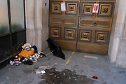 While office workers remain at home in accordance to government Covid guidelines and individual corporate policies, litter has blown towards the entrance of a closed business in the City of London, the capital's financial district, during the third lockdown of the Coronavirus pandemic, on 9th March 2021, in London, England.