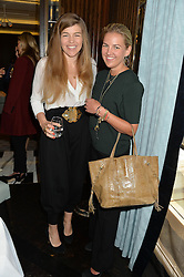 Left to right, AMBER NUTTALL and HANNELI RUPERT  at the 'Ladies of Influence Lunch' held at Marcus, The Berkeley Hotel, London on 12th May 2014.