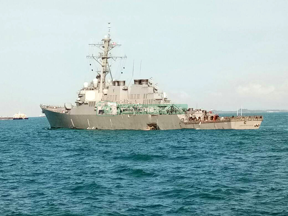 Aug. 21, 2017 - Putrajaya, Malaysia - The damaged U.S. navy destroyer John S. McCain at sea. Malaysian authorities said assets had been deployed to join the search and rescue operation for 10 missing sailors after the U.S. navy destroyer John S. McCain collided with a merchant vessel near the Strait of Malacca. (Credit Image: © Xinhua via ZUMA Wire)