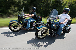 Father and son ride together - Ken McManus (R) rides his 1936 Harley-Davidson Knucklehead beside his son Matt McManus on an exactly identical machine during Stage 5 of the Motorcycle Cannonball Cross-Country Endurance Run, which on this day ran from Clarksville, TN to Cape Girardeau, MO., USA. Tuesday, September 9, 2014.  Photography ©2014 Michael Lichter.