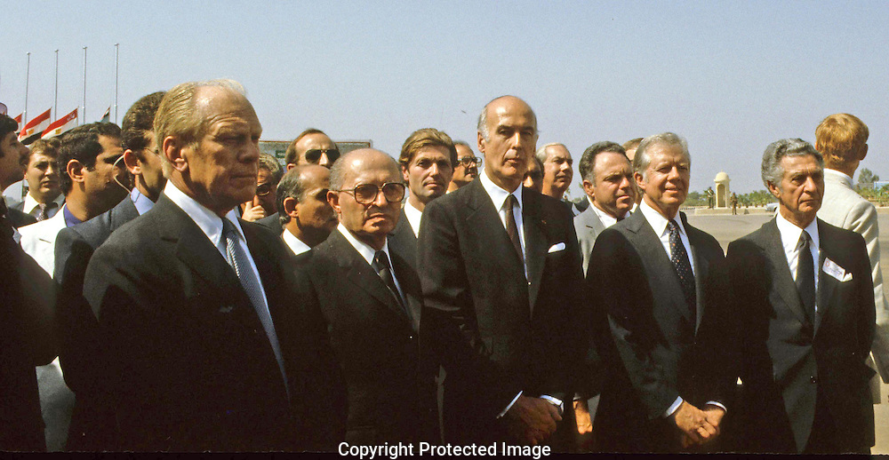 The United States delegation waits to proceed during the funeral of Anwar Sadat.  left to right: President Ford, Menachem  Begin,Giscard d'Estang,President Carter, Sol Linowitz,..Photograph by Dennis Brack bb 34