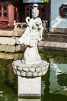 ancient statue on a pond in Fang Bang Zhong Lu old city Shanghai China