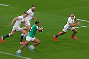 A slow shutter speed shot of Bundee Aki of Ireland running with the ball during the Six Nations international rugby union match between England and Ireland at Twickenham stadium, Sunday, Feb. 23, 2020, in London, United Kingdom.  England won the match 24-12. (Mitchell Gunn/ESPA-Images-Image of Sport)