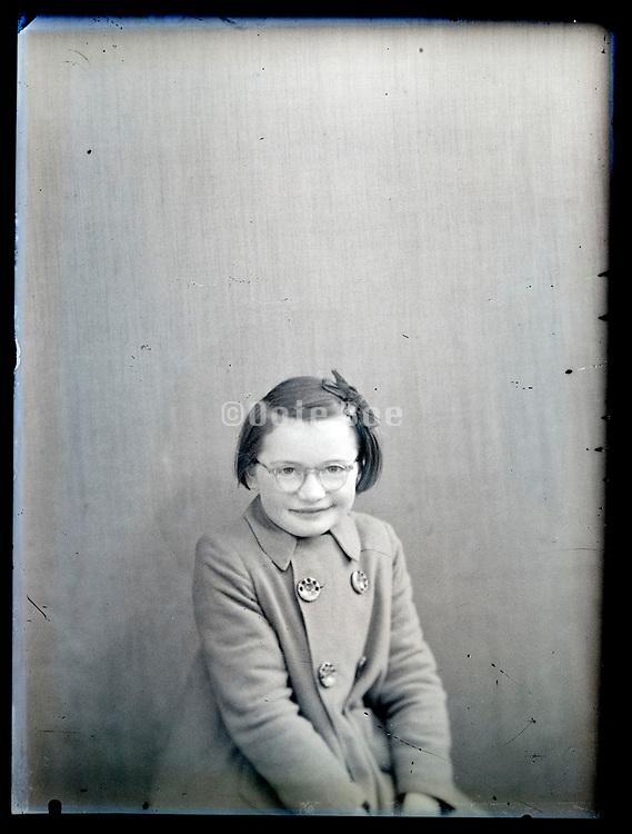 vintage studio portrait of smiling young female person, circa 1930s