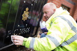 © Licensed to London News Pictures . 18/09/2013 . Hyde , UK . KEITH WHALE , who built the original memorial as a gift to Hyde Police station , cleans and polishes it ahead of the service . Flowers and tributes in memory of PCs Fiona Bone and Nicola Hughes at a memorial garden at Hyde police station this morning (18th September 2013) . The two PCs were on duty one year ago today (18th September 2012) , when they were murdered by Dale Cregan , whilst responding to a fake 999 call that he'd placed . A private family memorial event is due to take place at the gardens later this morning (18th September 2013) at 10:53 , at the time to two were murdered . Photo credit : Joel Goodman/LNP
