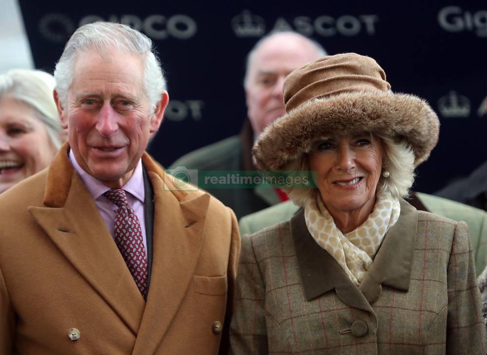 The Prince of Wales and the Duchess of Cornwall presents the winning syndicate of Fortunate George after the horse won the Waitrose Handicap Steeple chase at Ascot Racourse.