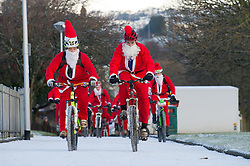 © under license to London News Pictures.  18/12/2010 Bikers from a local Plymouth bike club dressed as Santa cycle up a snow covered path towards Plymouth Hoe this morning (18/12/2010). Snow and cold weather has hit much of the South West of England. Picture credit should read: David Hedges/LNP.