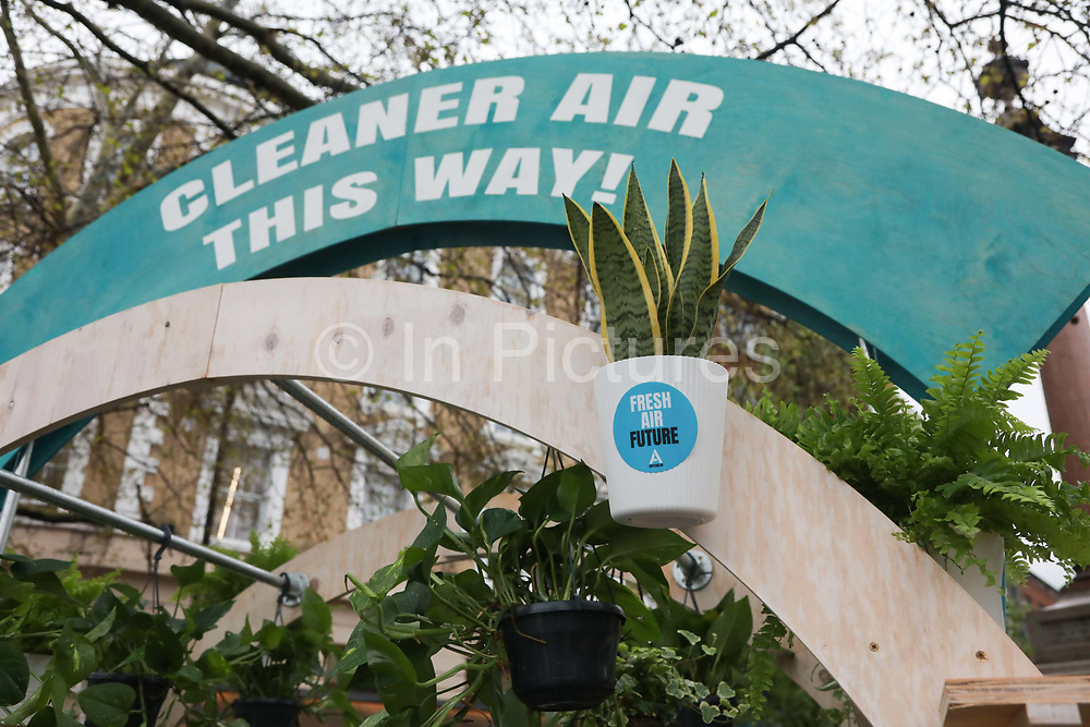 Parents and children from 'The Air Team', an air pollution campaign group, celebrate the arrival of London's Ultra Low Emission Zone (ULEZ), on 8th of April 2019 in London, Unted Kingdom. The new zone is one of the most ambitious clean air schemes in the world, and is expected to reduce road transport emissions by around 45%. An arch was set up with plant pots to be handed out to passersby and commuters were encouraged to walk through the arch.