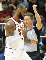 November 30, 2017 - Atlanta, GA, USA - Cavaliers' LeBron James pumps his first as he gets the score and one more drawing a foul from the Hawks during the first half in a NBA basketball game on Thursday, Nov. 30, 2017, in Atlanta. The Cavs beat the Hawks 121-114. (Credit Image: © Curtis Compton/TNS via ZUMA Wire)