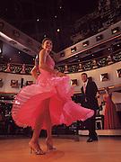 A couple dances at the ballroom aboard a cruise ship