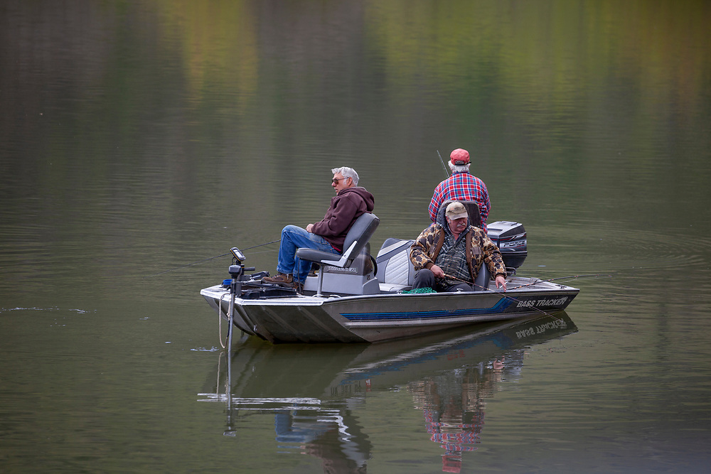 3 Good Old Boys fishing calm waters on Brownlee Reservoir on the Snake River in Hells Canyon.  Open Edition Prints and Editorial Only.
